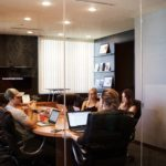 people around table having meeting in conference room
