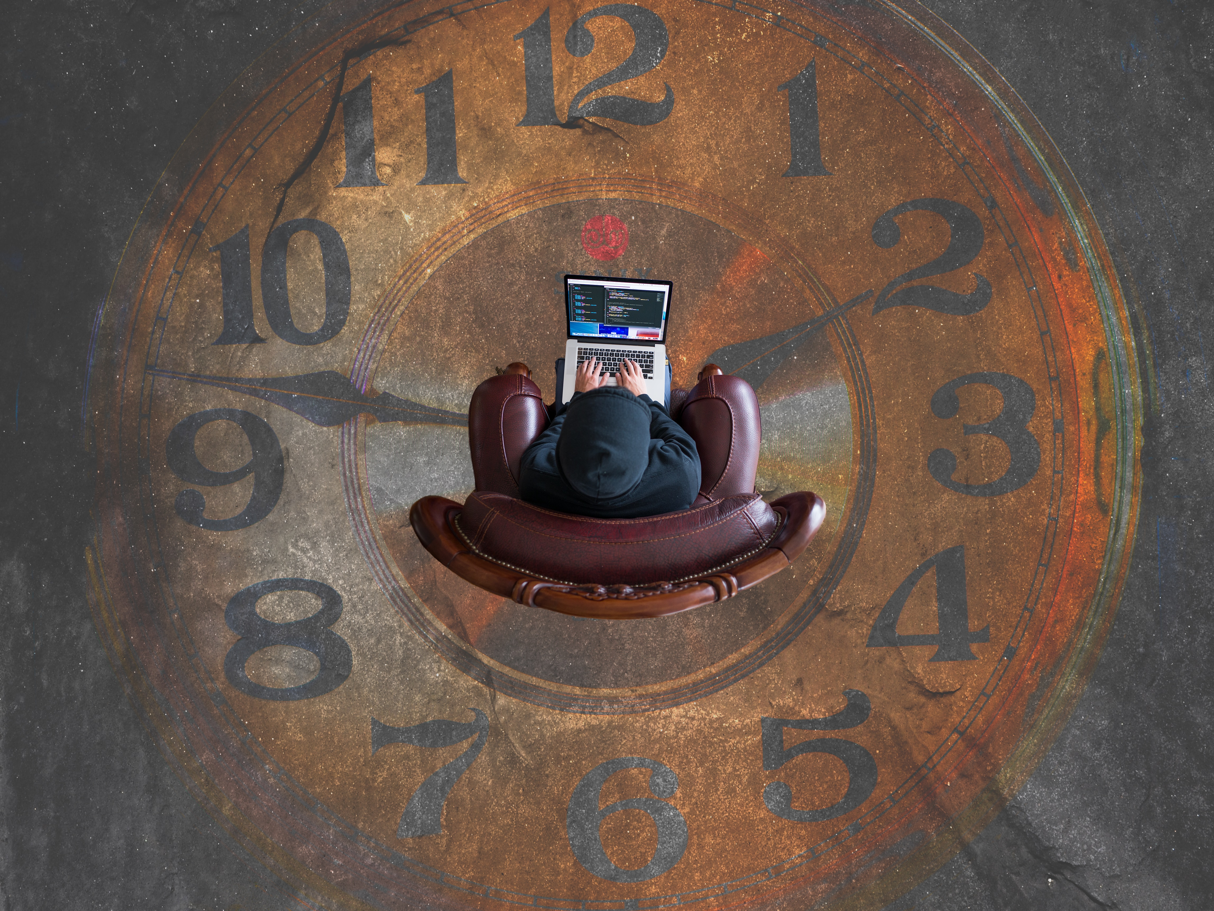 person sitting in chair on clock shaped rug