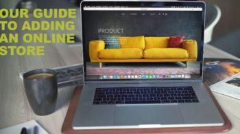 macbook with furniture website on screen