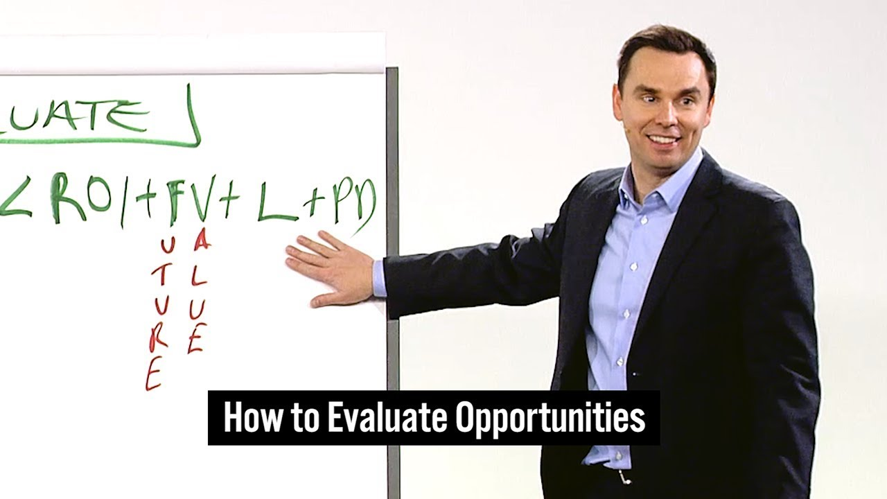 Brendon Burchard standing in front of whiteboard