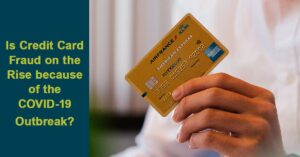 man holding up credit card