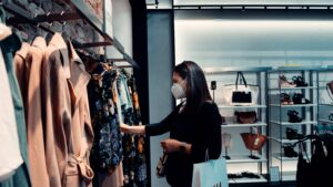 Woman shopping with face mask on during COVID-19