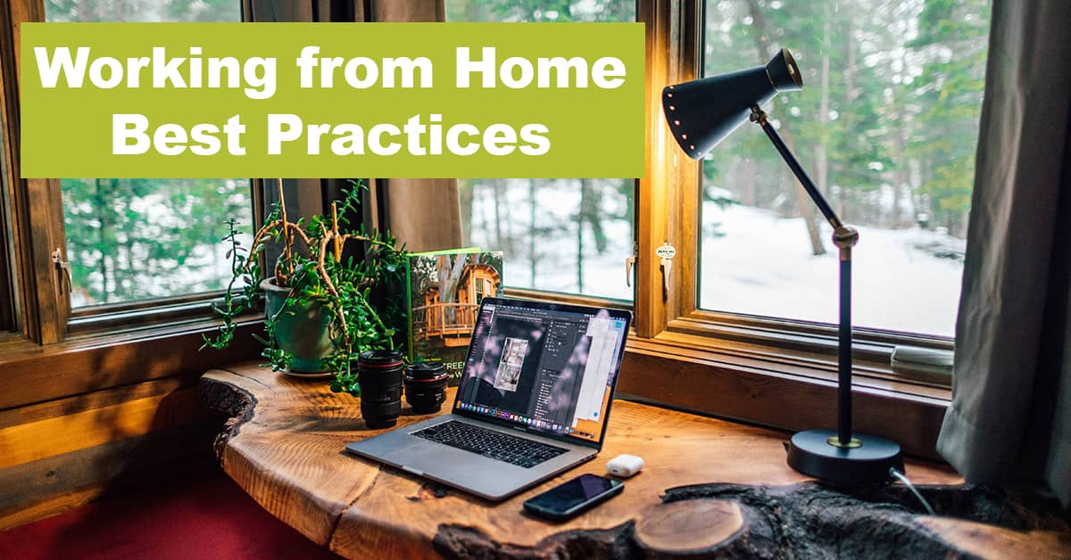 Work from home setup with lamp shining over laptop
