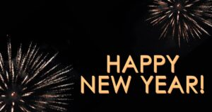 """Golden """"Happy New Year"""" text on top of a black background with two gold fireworks."""