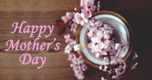"""""""Happy Mother's Day"""" social media post idea with pink text and pink flower imagery."""