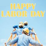 """4 men wearing hard hats and blue shirts walk up a ladder to the words """"Happy Labor Day""""."""