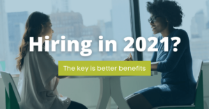 """Recruiter and candidate chatting in front of window. text """"Hiring in 2021? The key is better benefits"""""""