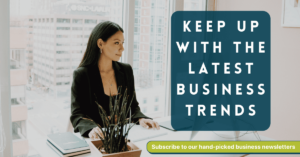 """White text """"Keep up with the latest business trends"""" on blue background. Image of woman sitting at desk in a bright white office."""