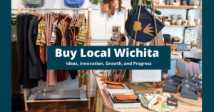 """Image of small retail store on a dark blue background. Test in the front says """"Buy Local Wichita"""""""