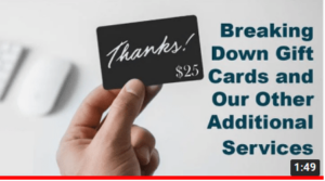 Image of person holding giftcard that says