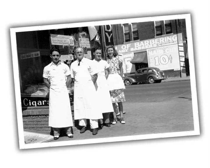 Black and white photograph of the Woermke family standing outside of local Old Mill Tasty Shop restaurant