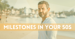 """Man in his 50s on a beach. Yellow overtone with white text that says """"Milestones in your 50s"""""""